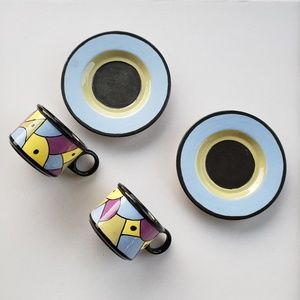 Handmade and painted cappuccino mugs and saucer